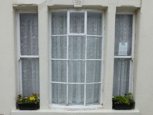 before the sash and casement window restoration started in worthing west sussex